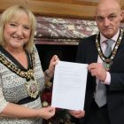 Lord Mayor of Manchester Cllr June Hitchen and the Lord Mayor's Consort Cllr Carmine Grimshaw with Manchester's Nuclear Weapons Prohibition Treaty resolution